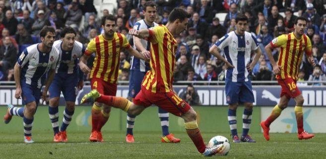 Messi shoots a penalty in the derby of Barcelona. The football (soccer) game between FC Barcelona and RCD Espanyol.