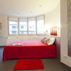 Large red bed with Sagrada Familia motif