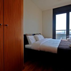 Cozy Master Bedroom with Balcony Access