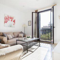 Sunny living room with balcony access