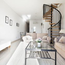 Elegant staircase winding up to the second floor