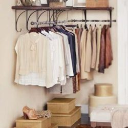 Hang a clothes rack in the corner