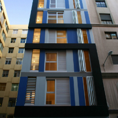 A picture of a minimalist apartment building in Barcelona
